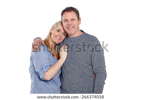 Portrait of happy mature couple standing together on white background - stock photo