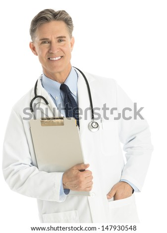 Portrait of happy mature male doctor holding clipboard while standing isolated over white background
