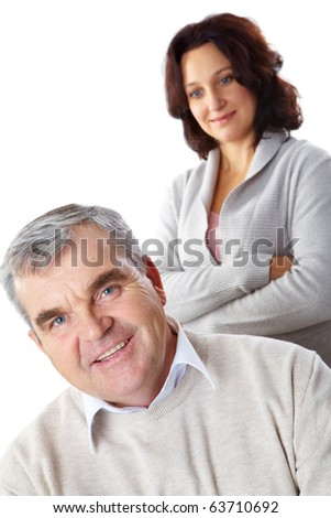 Portrait of happy mature man looking at camera with woman on background