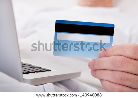 Portrait Of Happy Mature Man Shopping Online - stock photo