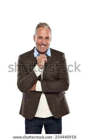 Portrait of happy mature man standing against white background - stock photo