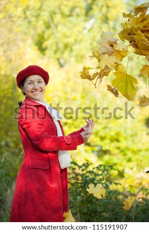 Portrait of happy mature woman  in autumn park