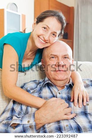 Portrait of happy mature woman with senior husband