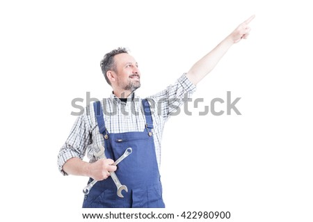 Portrait of happy mechanic pointing finger up and holding tools isolated on white - stock photo