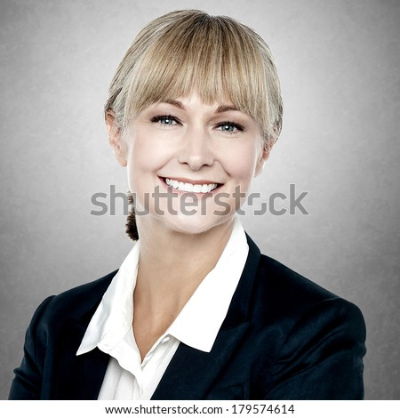 Portrait of happy middle aged business woman  - stock photo