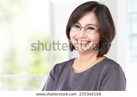 portrait of happy middle aged business women - stock photo