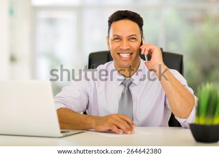 portrait of happy middle aged corporate worker talking on cell phone - stock photo