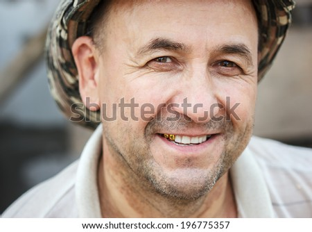 Portrait of happy middle aged smiling man