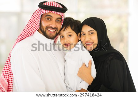 portrait of happy middle eastern family - stock photo