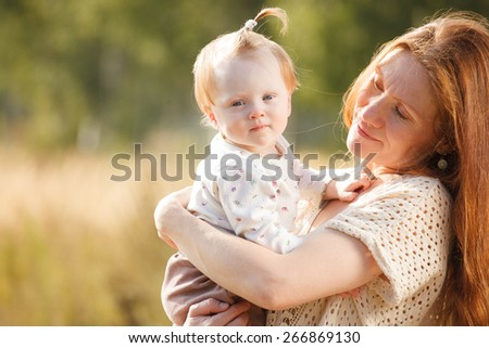 Portrait of happy mother and child outdoor