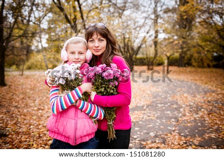 Portrait of happy mother and daughter. autumn. outdoor - stock photo