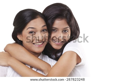 Portrait of happy mother and daughter embracing - stock photo