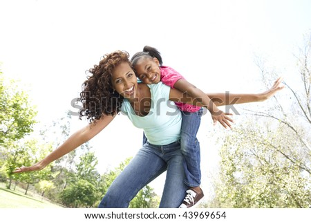 Portrait of Happy Mother and Daughter In Park - stock photo