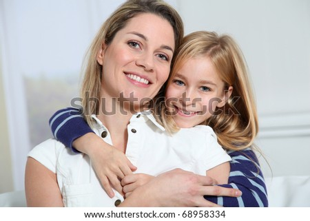 Portrait of happy mother and little girl - stock photo