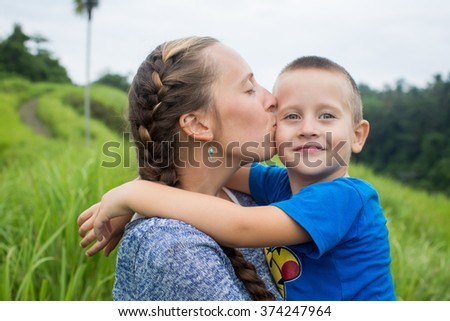 Portrait of happy mother and son at nature, Bali