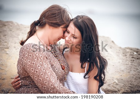portrait of happy mother and the daughter on the seashore