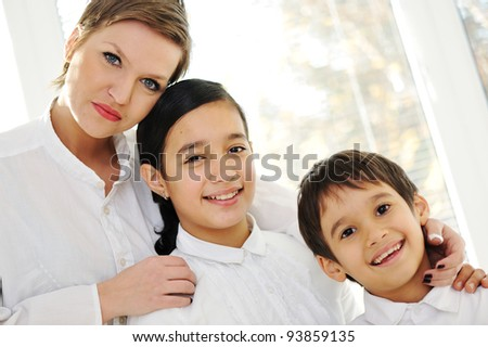Portrait of happy mother daughter and son at home