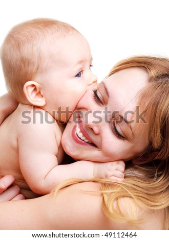 Portrait of happy mother embracing her charming baby