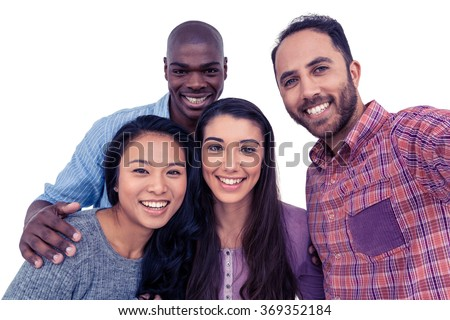 Portrait of happy multi-ethnic friends against white background - stock photo