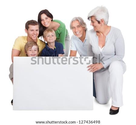 Portrait of happy multigeneration family. Isolated on white - stock photo