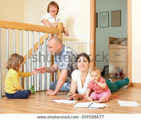 Portrait of happy multigeneration family with little children communicate at home in linibf room