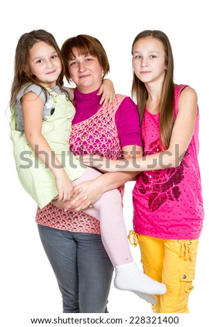 Portrait of happy mum with two daughters isolated on white background - stock photo