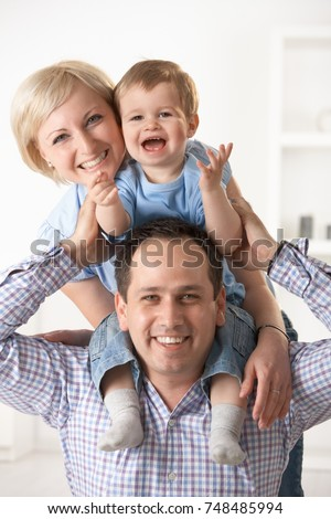 Portrait of happy nuclear family having fun together at home.