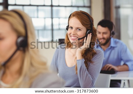 Portrait of happy operator with headset - stock photo