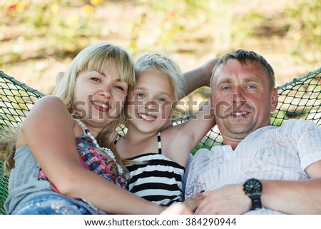 Portrait of happy parents with their daughter - stock photo