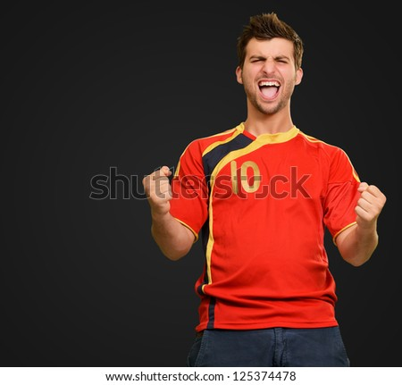 Portrait Of Happy Player On Black Background - stock photo