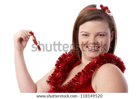 Portrait of happy plump woman at Christmas, with christmas fondant, smiling. - stock photo