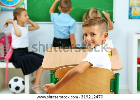 Portrait of happy pupil at lesson - stock photo