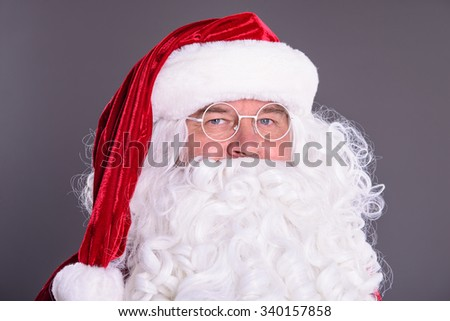 portrait of happy Santa Claus on gray background