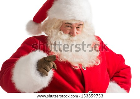 Portrait of happy Santa Claus pointing at you isolated on white background