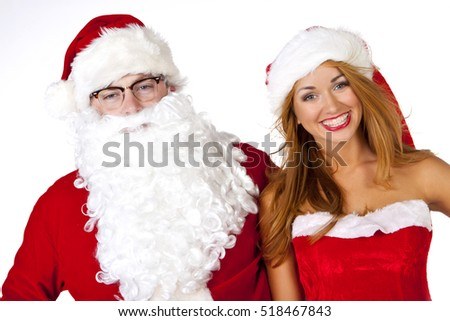 Portrait of happy Santa Claus with santa woman