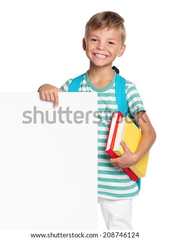 Portrait of happy schoolboy with white blank isolated on white background - stock photo