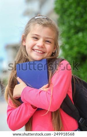 portrait of happy schoolgirl outdoors - stock photo