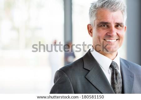 portrait of happy senior business man - stock photo