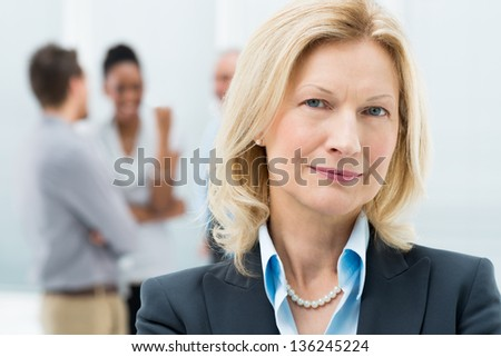 Portrait Of Happy Senior Businesswoman In Office - stock photo