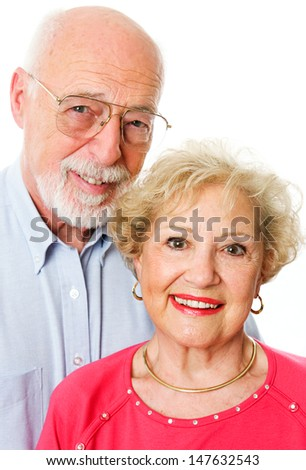 Portrait of happy senior couple isolated on white background.
