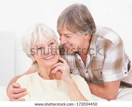Portrait Of Happy Senior Couple Smiling At Home - stock photo