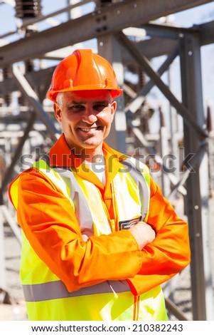 portrait of happy senior electrical engineer in substation