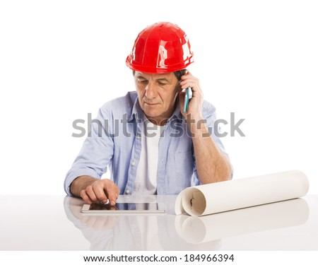 Portrait Of Happy Senior Engineer Making Phone Call And Looking To Plans Isolated Over White Background - stock photo