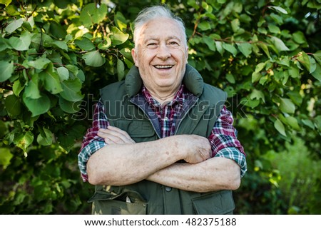 Portrait of happy senior gardener
