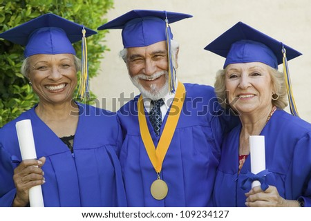 Portrait of happy senior graduates holding certificates