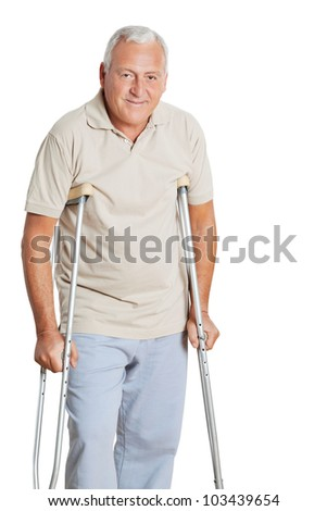 Portrait of happy senior man on crutches isolated over white background.