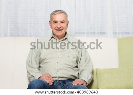 Portrait of happy senior man relaxing at home.Happy senior man