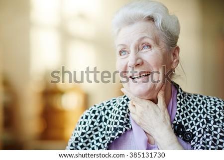 Portrait of happy senior woman - stock photo