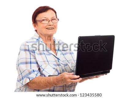 Portrait of happy senior woman holding laptop, isolated on white background. - stock photo