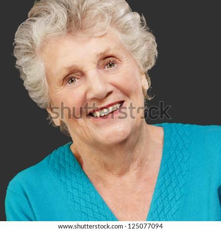 Portrait of happy senior woman isolated on black background - stock photo